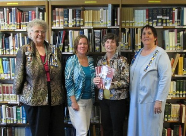 DAR members donating books to Martin County Libraries